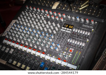 image of of an audio sound mixer with buttons and sliders . - stock photo