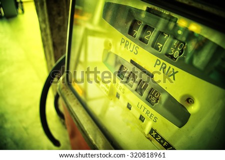 image of old analog gas pump meter, vintage effect - stock photo