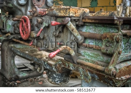 Image of old antique, rusty and dirty machine equipment in an abandoned high school. - stock photo