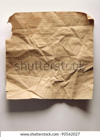 Image of old crumpled paper on wall - stock photo