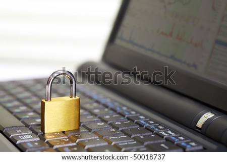 Image of open laptop keyboard with padlock on it