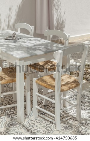 Image of outdoor terrace table and chairs.  - stock photo
