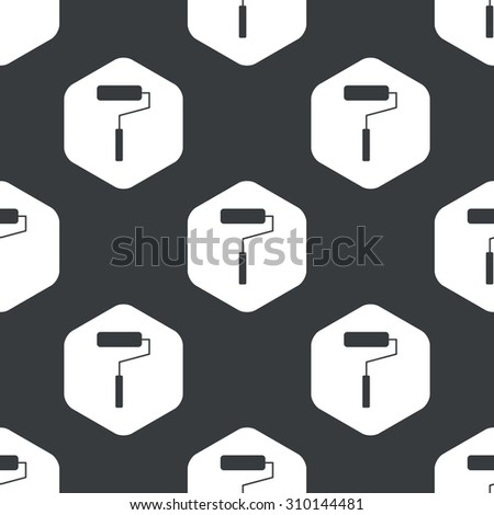Image of paint roller in hexagon, repeated on black - stock photo