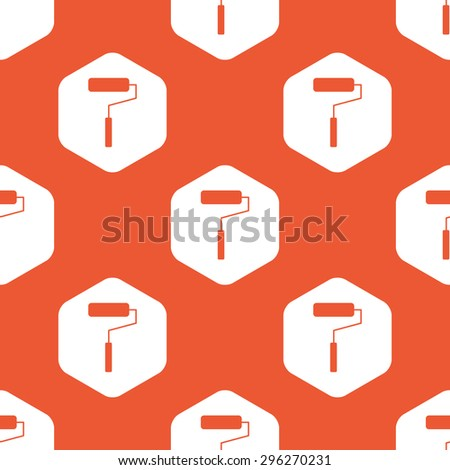 Image of paint roller in white hexagon, repeated on orange background - stock photo