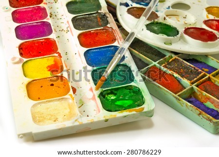 image of paints and brushes on a white background - stock photo