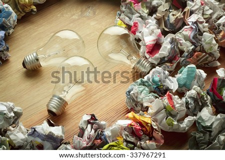 image of paper balls with bulb for brain storm concept - stock photo