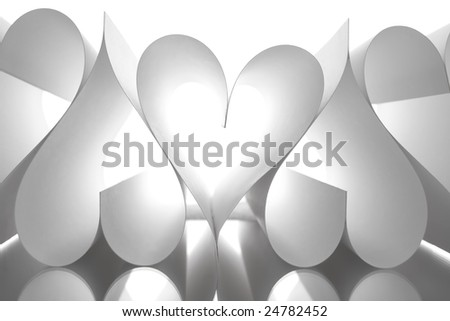 Image of paper sheets making up several heart shapes on white background - stock photo