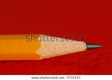 Image of pencil detail on red background