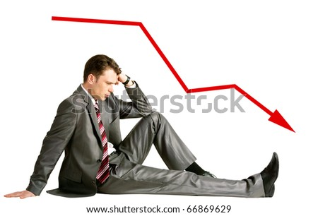 Image of pensive businessman sitting in studio with red arrow showing downward direction