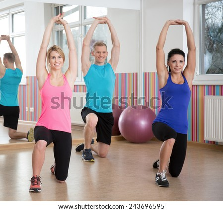 Image of people exercising in pilates class