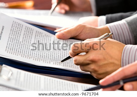 Image of people's hands making notes in lecture - stock photo