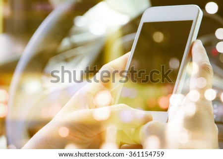 image of people sitting in the car using smart phone double exposure and blurred view of car on  street at night - stock photo