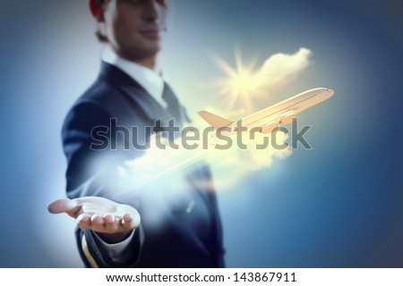 Image of pilot with airplane taking off from his hand - stock photo