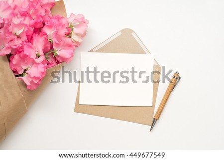 image of pink flowers and letter on white background