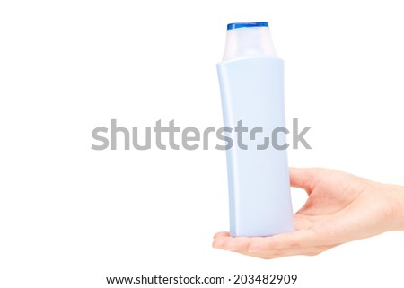 Image of plastic bottle with bodycare product on palm of female - stock photo