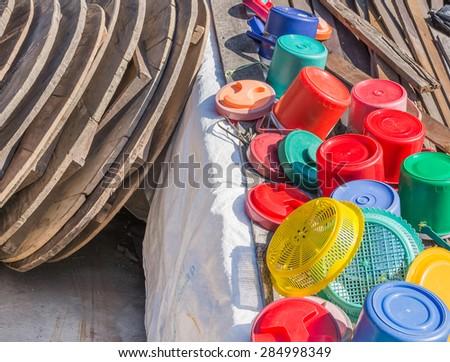 image of Plastic ice bucket  drain against the sun. - stock photo