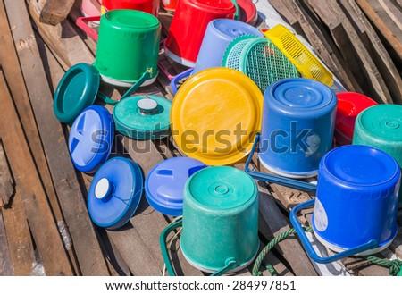 image of Plastic ice bucket  drain aginst the sun. - stock photo