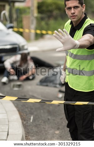 Image of policeman at car accident area - stock photo