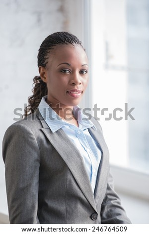 Image of pretty african businesswoman looking at camera - stock photo