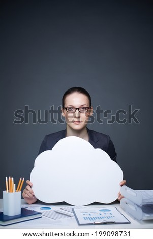 Image of pretty businesswoman in eyeglasses holding blank paper speech bubble - stock photo