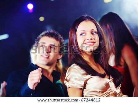 Image of pretty girl dancing on background of teenage friends - stock photo