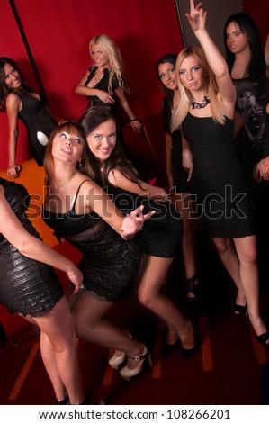 Image of pretty girls dancing in night club - stock photo
