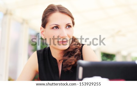 Image of pretty young woman in cafe - stock photo