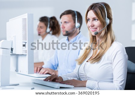 Image of professional workers of telemarketing service - stock photo