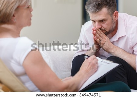 Image of psychiatrist supporting her patient with mental problem - stock photo