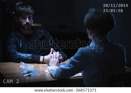 Image of recording from police interrogation of young suspect - stock photo