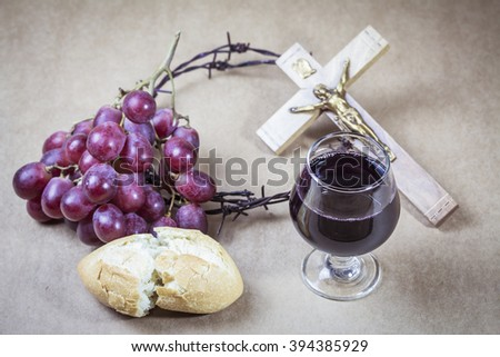 image of red grape, cup of grape juice, bread, metal Barbed Wire made like the crown of thorns  with the crucifix of jesus on wooden background, Communion concept, Easter background - stock photo