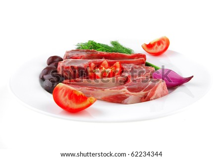 image of red meat ribs and greenery