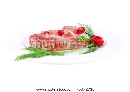 image of red veal ribs with greenery and pepper