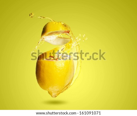Image of refreshing lemon cocktail with juicy splashes - stock photo