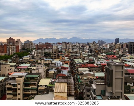 Image of residential area of New Taipei City, Taiwan. Cloudy sky.