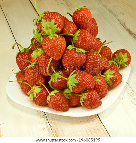 image of ripe and tasty strawberries on plate - stock photo