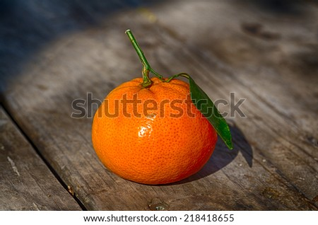 Image of ripe oranges on a rustic wood background. - stock photo