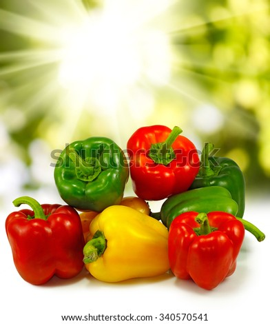 image of ripe peppers against the sun close-up - stock photo