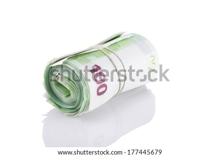 Image of roll of one hundred euro banknotes with a rubber band, isolated on the white background - stock photo