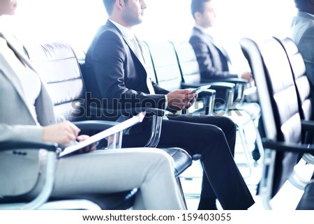 Image of row of business people at seminar - stock photo