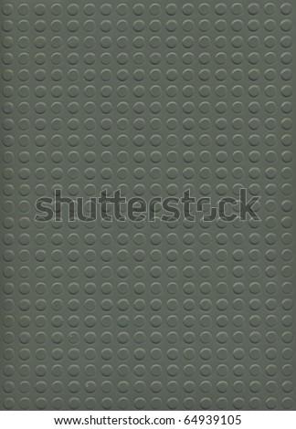 Image of rubber tile on black background - stock photo