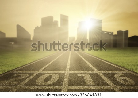 Image of running track with numbers 2016 on the start line, shot in the morning - stock photo