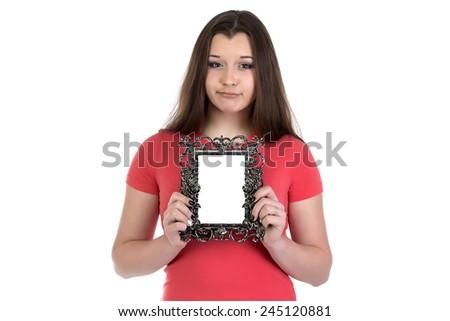Image of sad teenage girl with photo frame on white background - stock photo