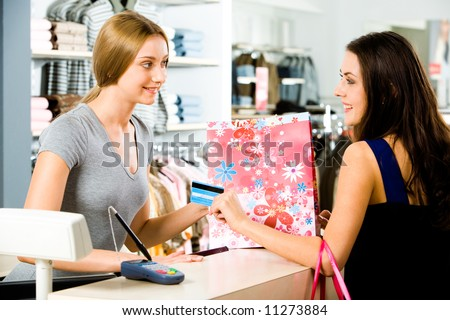 Image of salesperson selling something to attractive buyer - stock photo