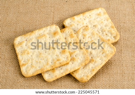 Image of saltine crackers on brown sack background