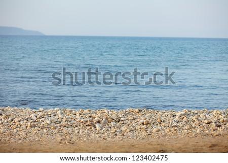 Image of sandy beach and sea - stock photo