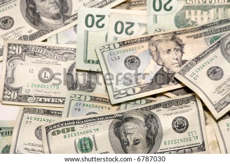image of scattered united states currency, twenties and hundreds, suitable for a background