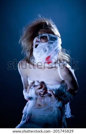 Image of screaming girl-mummy posing at camera - stock photo