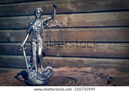 image of sculpture of themis, femida or justice goddess on wood lining copy space background - stock photo