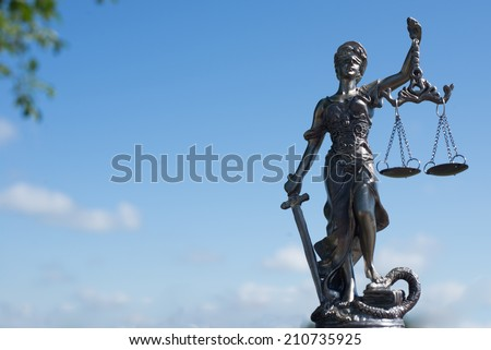 image of sculpture of themis, femida or lady justice goddess on bright blue sky copy space background - stock photo
